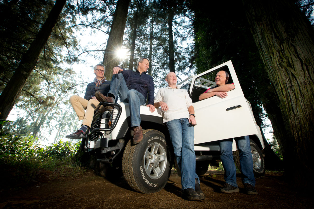 Groomsmen sitting on a landrover at Cranford Country Lodge