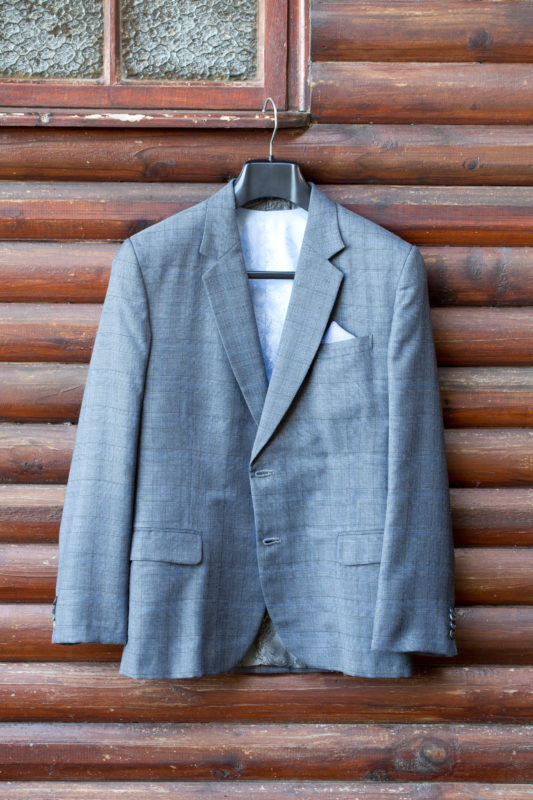 Wedding Jacket against a wooden wall