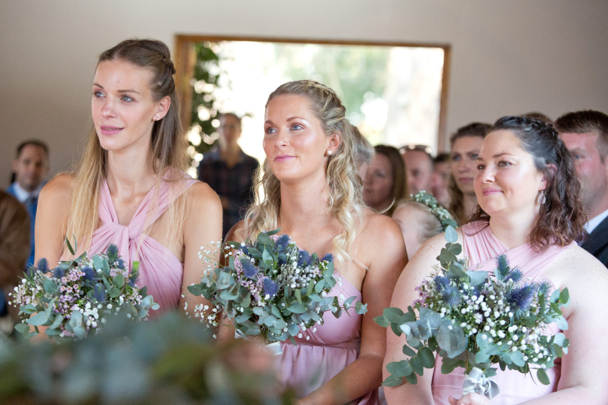 Bridesmaids watching the groom and bride get married
