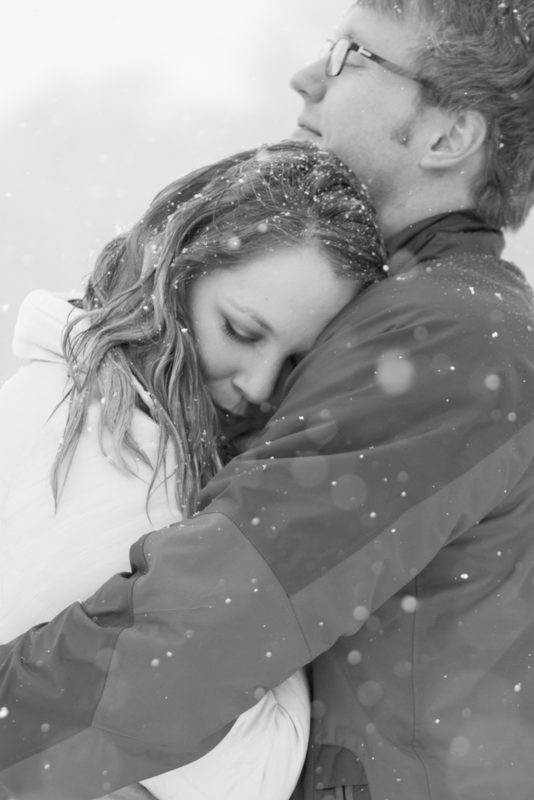 A beautiful hug in the black and white image in the snow