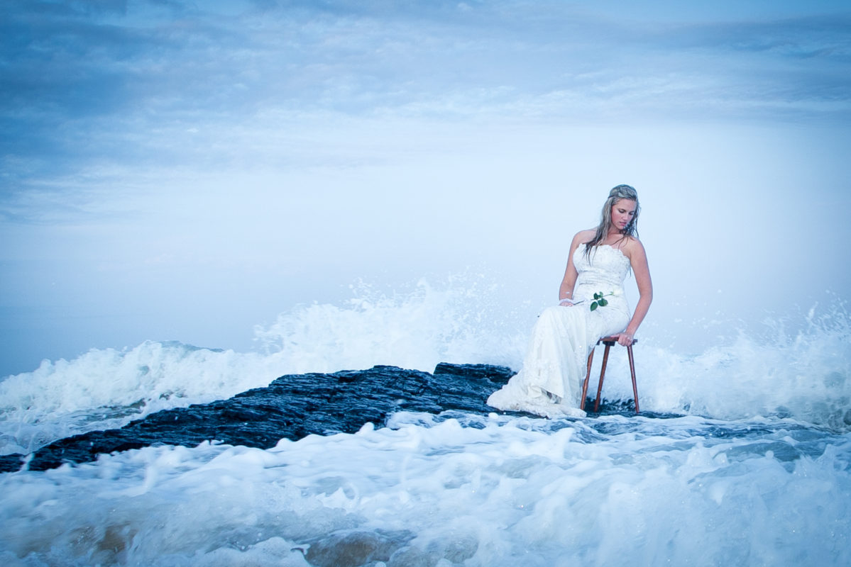 The bride looking like a mermaid for her trash the dress shoot