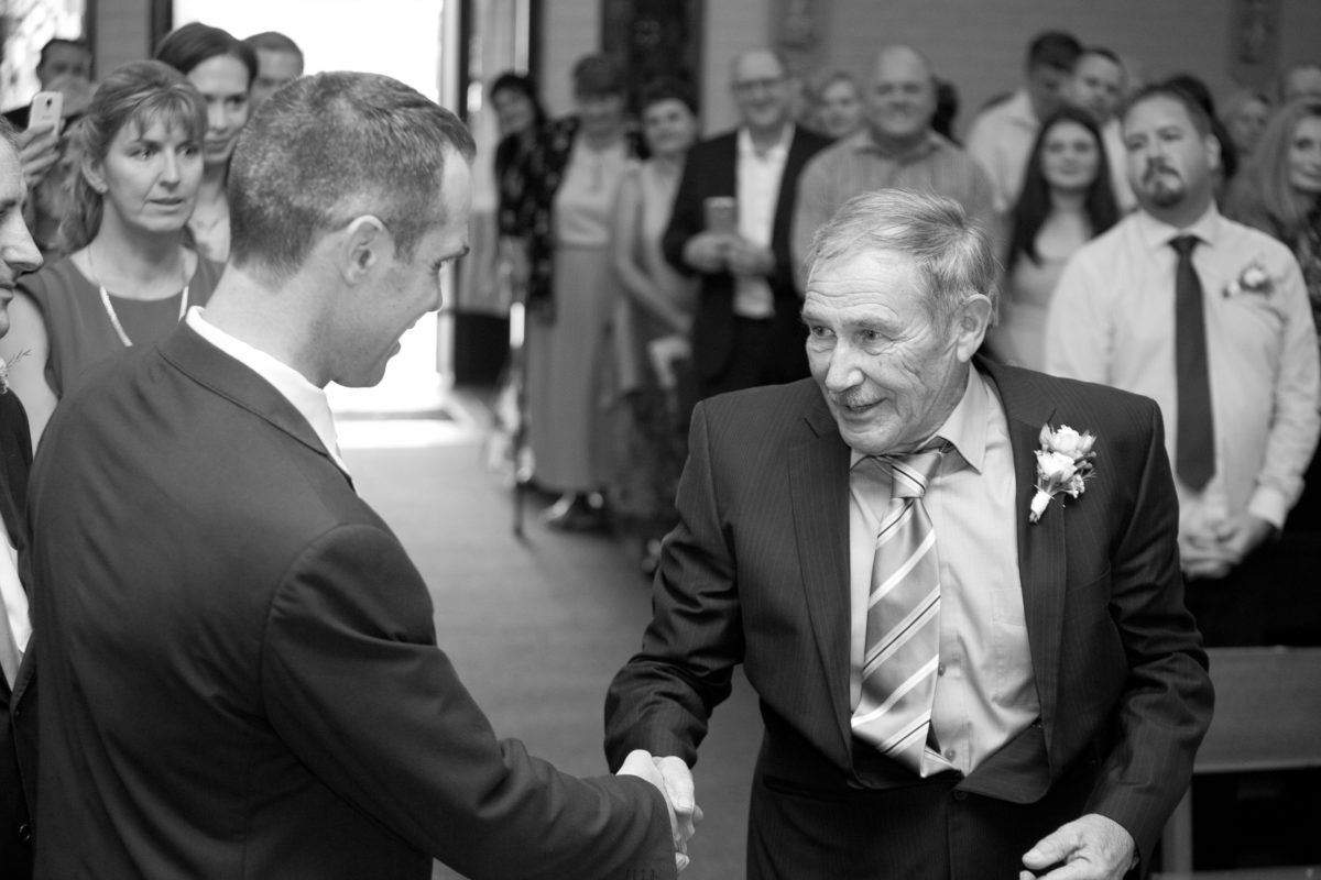 Groom and Father of the bride hand shake