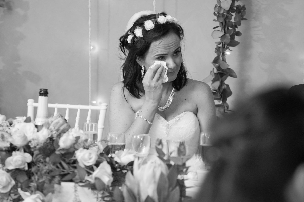 The bride having a tear to the grooms speech