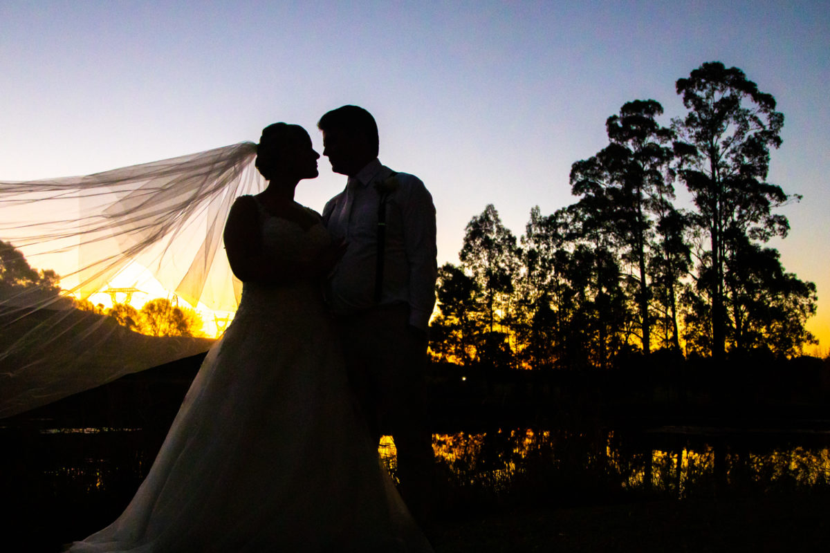 Cranford Country Lodge Sunset with bride and groom