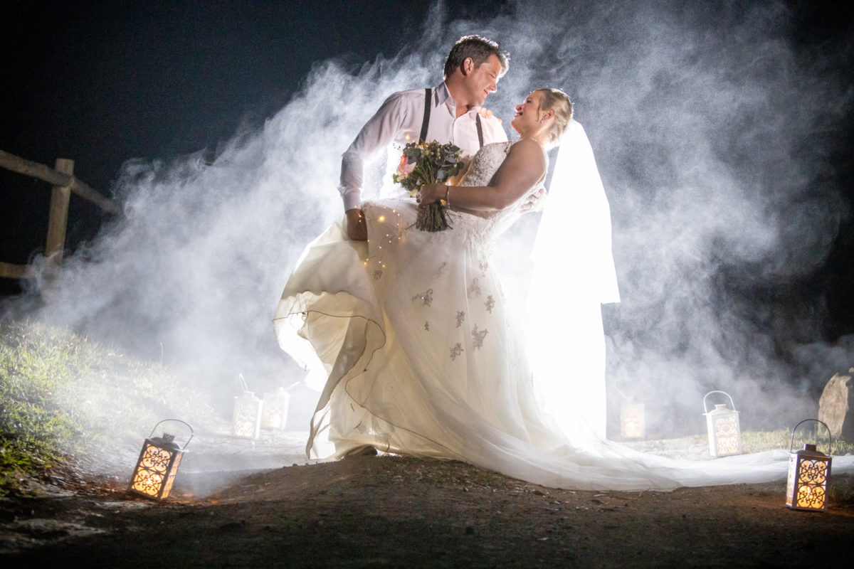 Cranford Country Lodge bride and groom with smoke