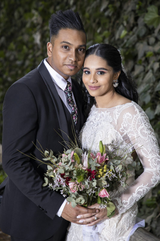 a potrait image of the bride and groom at their venue Waterwoods.
