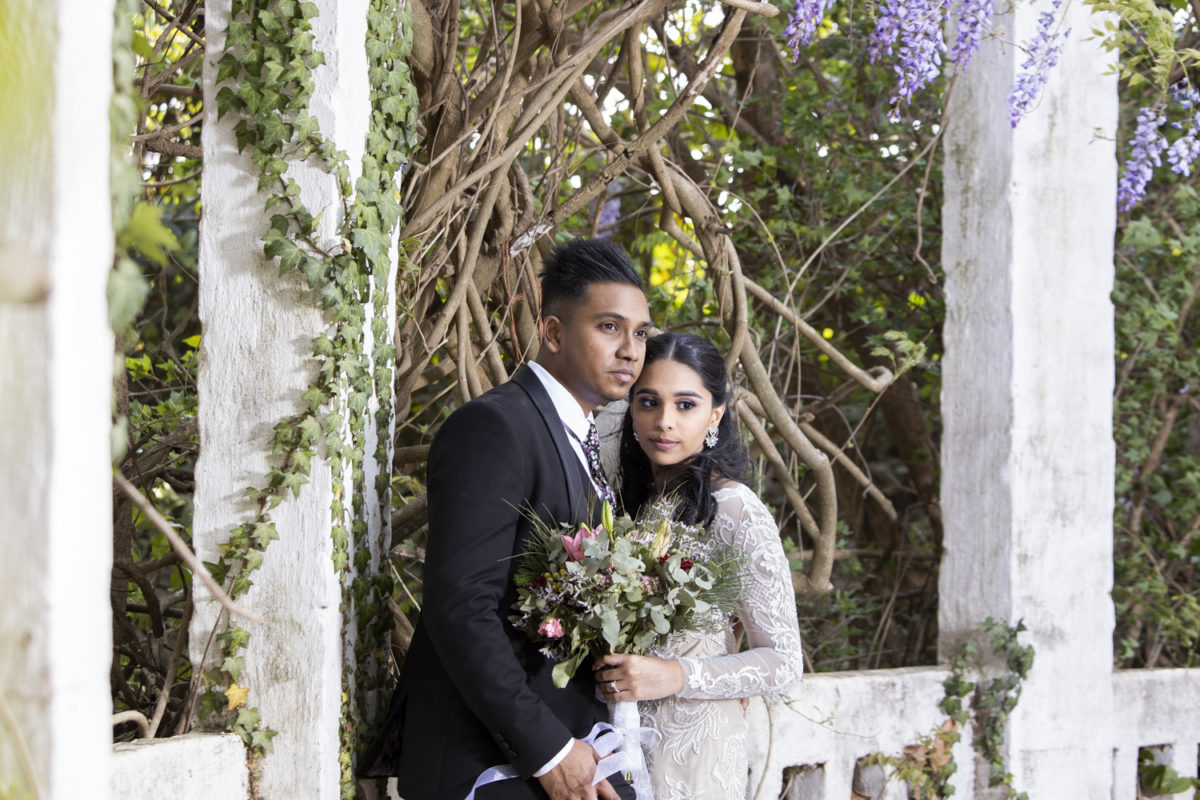the bride and groom looking into the distance at the beautiful Waterwoods wedding