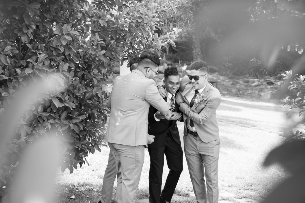 The groomsmen playing with the groom at a Waterwoods wedding