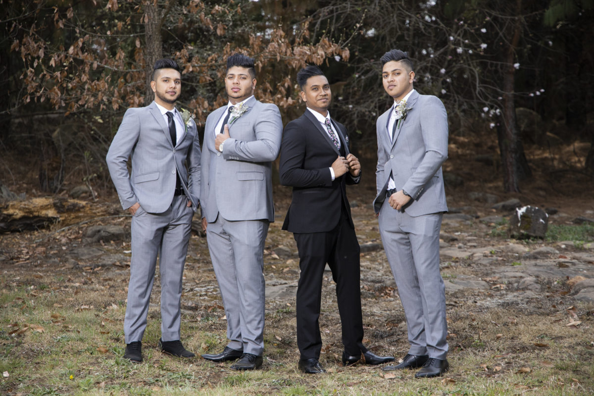 A groupshop of the groom and his groomsmen at a Waterwoods Wedding
