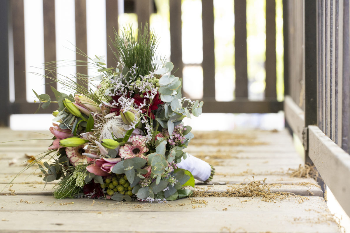 A brides Bouquet on a staircase at a Waterwoods Wedding