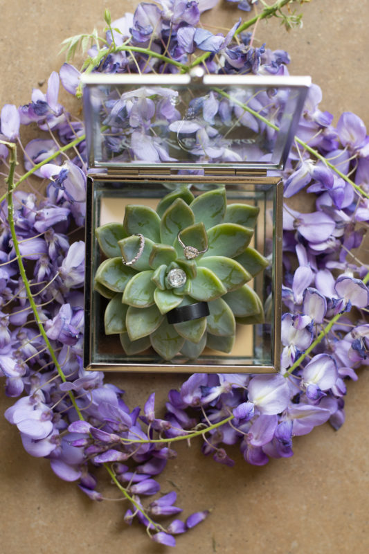 The wedding rings in a beautiful box surronded by flowers at a Waterwoods Wedding