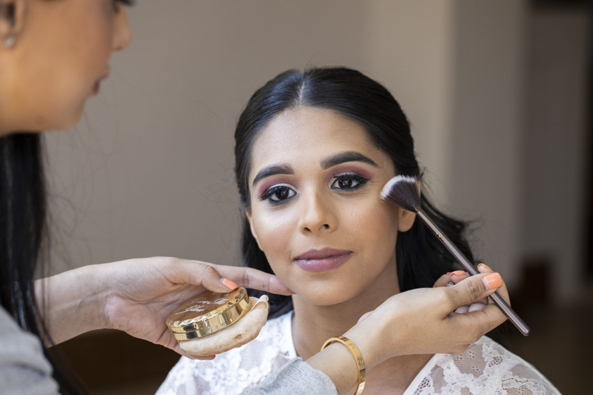 A bride having her make up done at a Waterwoods wedding