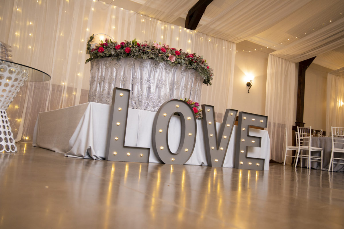 A love light in the reception of a Waterwoods Wedding