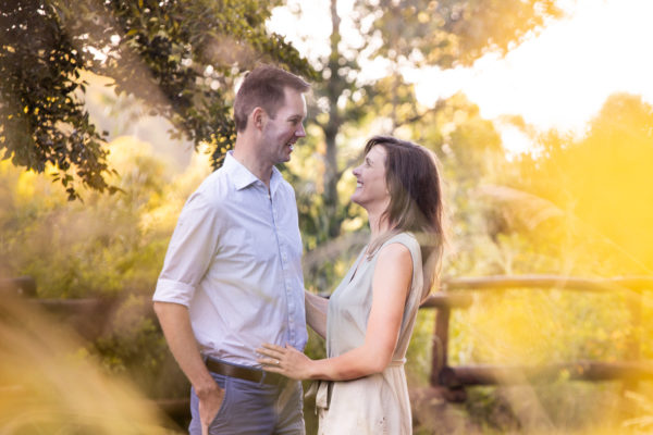 Winding river rustic engagement shoot with the couple through the beautiful flowers