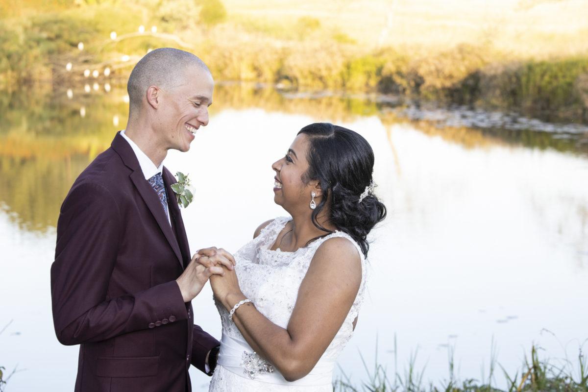 Eden Lassie Wedding lake cute bride and groom giggle