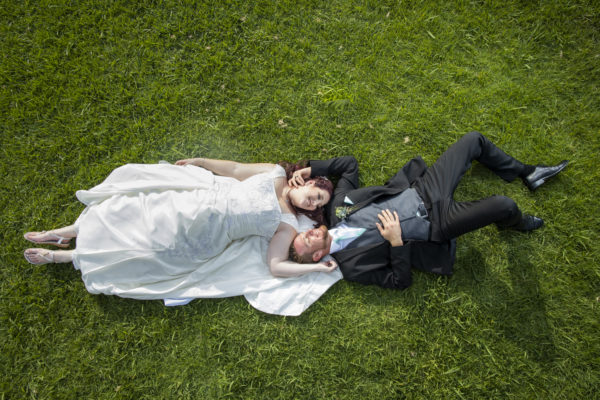 Calderwood Hall Bride and Groom on the grass