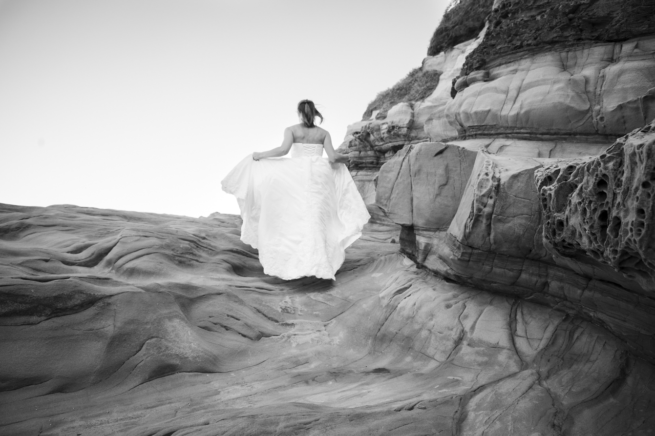 smokey water trash-the-dress bride running away