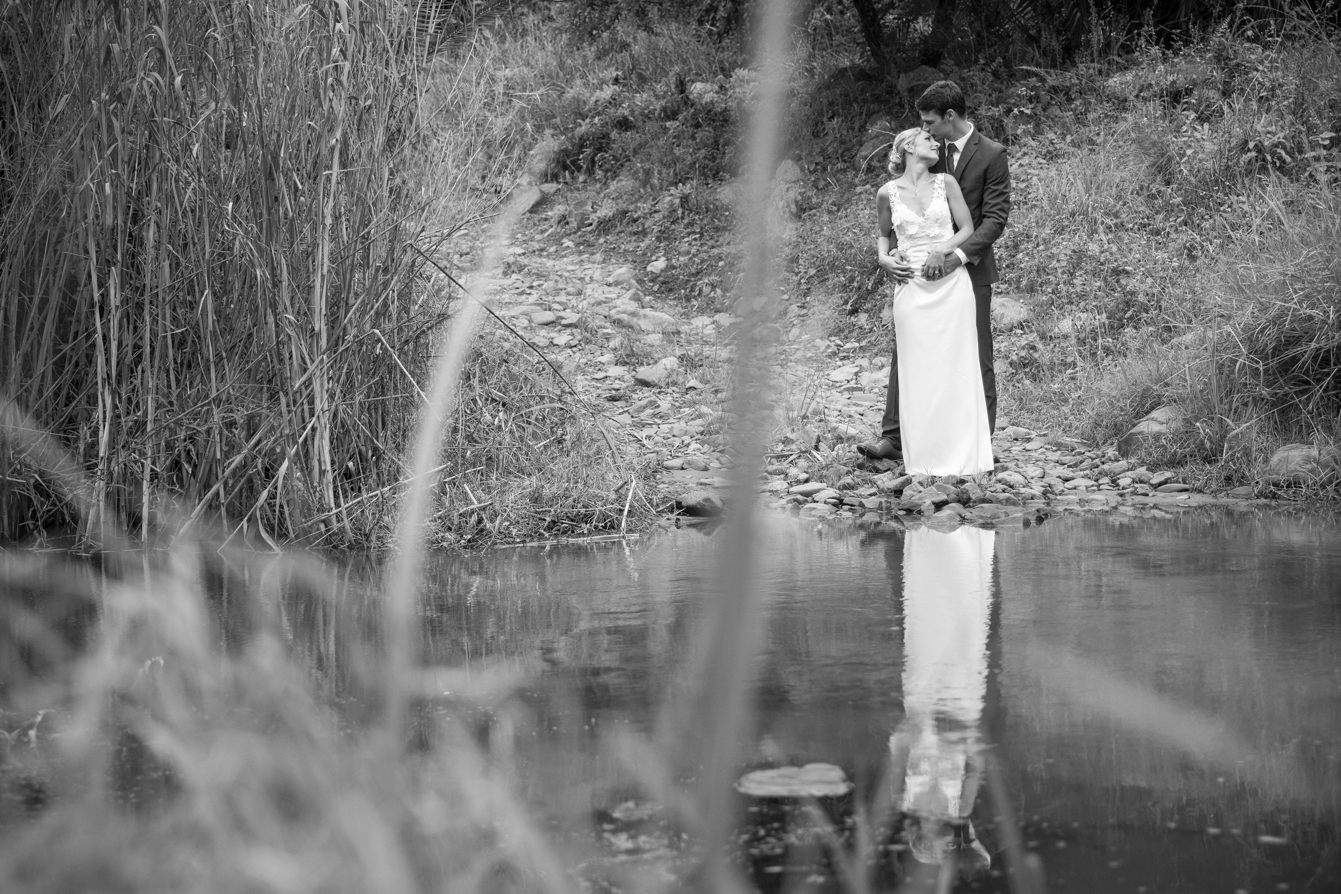 Photographer at Gwahumbe wedding with the bride the other side of the river with the groom in the midlands