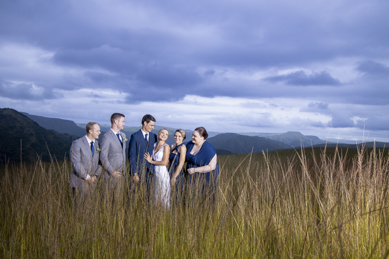 Photographer at Gwahumbe wedding with the bridal party and beautiful clouds  in the midlands