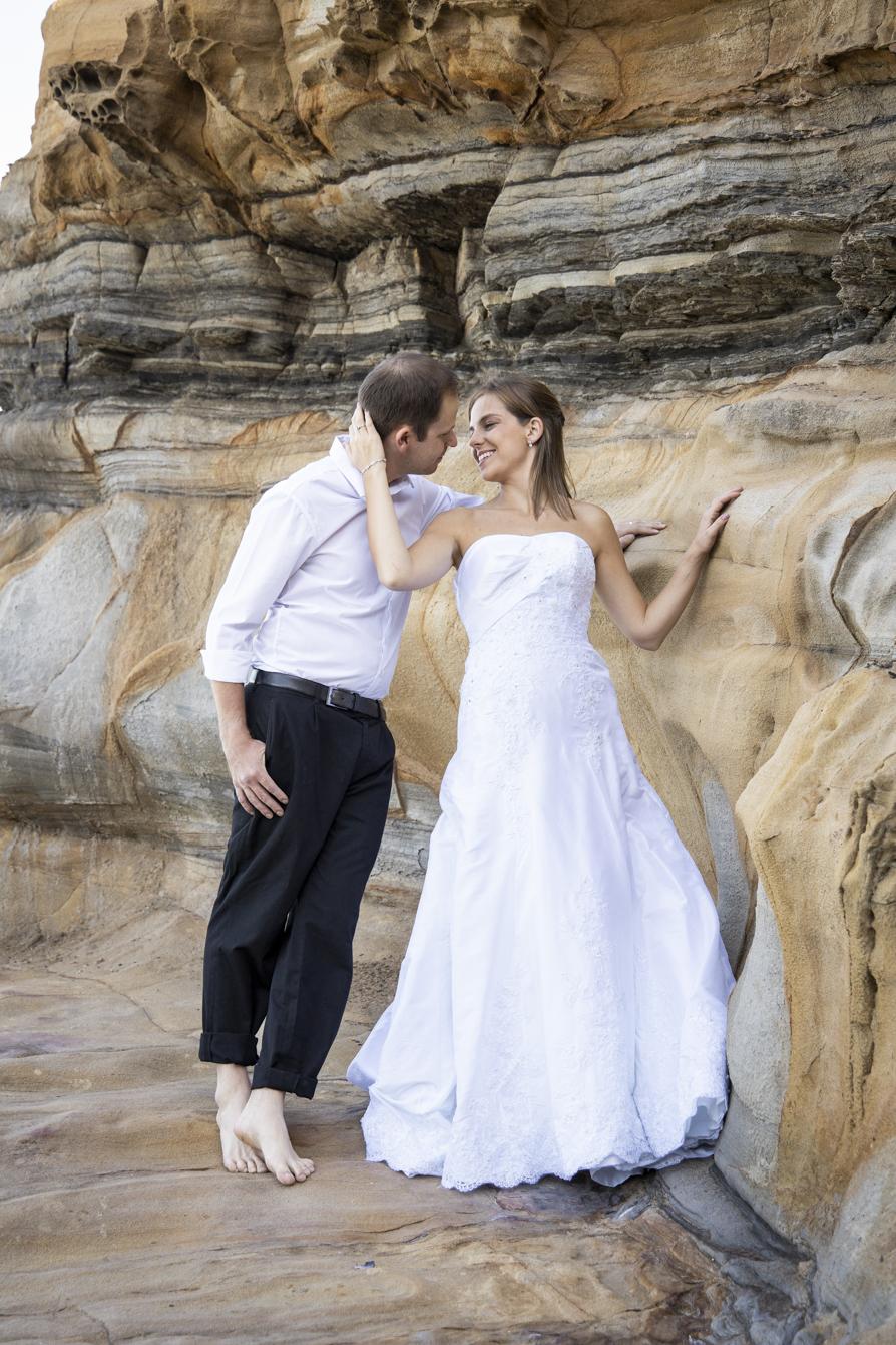 smokey water trash-the-dress kissing bride and groom