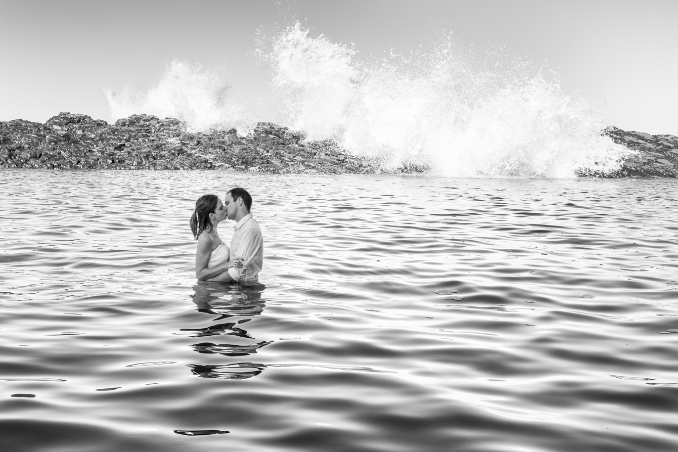 smokey water trash-the-dress bride and groom kissing in the pool
