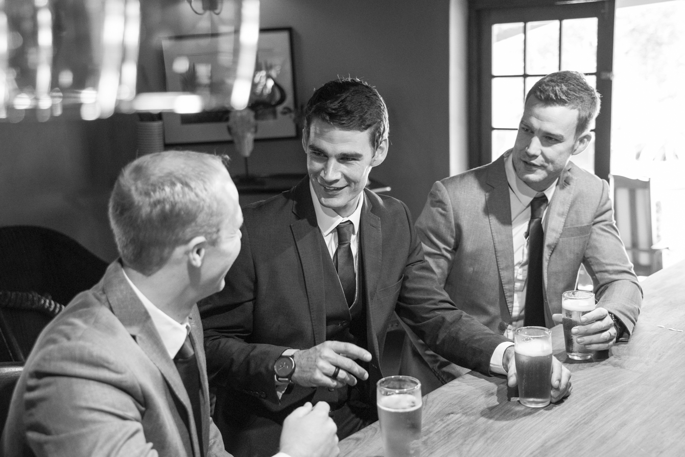 Photographer at Gwahumbe with the groom and groomsmen having a beer  in the midlands