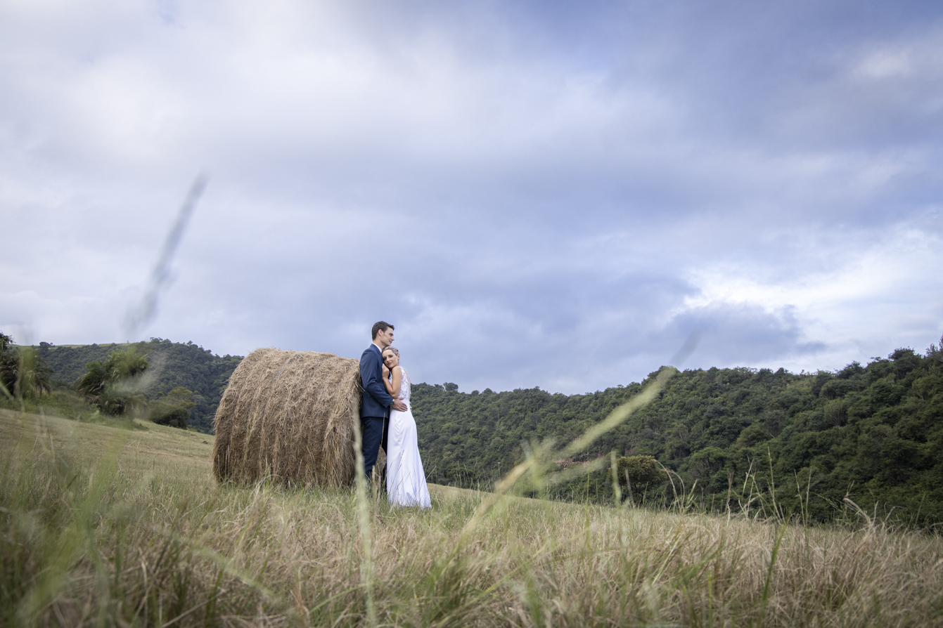 Photographer at Gwahumbe wedding the bride and groom in front of a hay bundle in the midlands